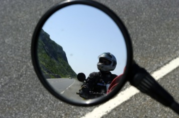 One of my favorite motorcycling pictures: me framed in my husbands mirror along the Gaspe cliffs.