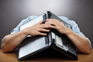 frustrated-worker-computer-over-head-300x199