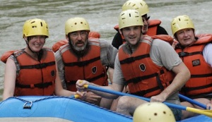 Me, my dad, my husband, and my mom watching the lead boat brave rapids in Costa Rica. If you think those expressions are good, you should have seen us zip-lining!
